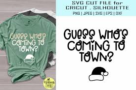 Guess Whos Coming To Town Graphic By Midmagart Creative Fabrica In 2020 Guess Christmas Shirts Christmas Svg