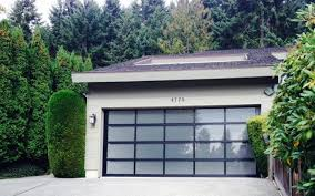 beautiful glass garage door by clopay with frosted glass and a black anodized frame compliment