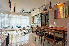 view in gallery raw concrete wall and lighting in the living area give the singapore home an industrial overtone