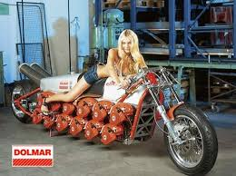 scantily clad chick presents chainsaw powered chopper car mods