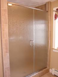 this is a shower door with pivot hinges and brushed nickel finish and rain glass this glass is a type of obscure glass with is easier to keep clean