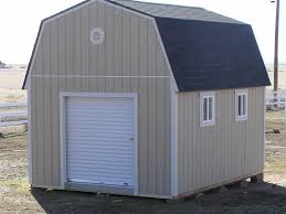 tall barn with 6 steel roll up door and 3x2 windows