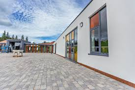 pupils have been attending lessons in temporary classrooms since the school s previous building suffered major fire damage in 2016 so the move has been
