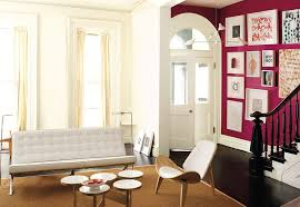 a vibrant entry hall offsets a clean lined living room