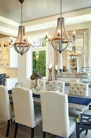 choosing the right size and shape light fixture for your dining room simple tips on placement fixtures barrels chandeliers wine wooden barrel stave