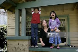 Wendy Carlson with her two adopted children from Korea: Fraser... News  Photo - Getty Images