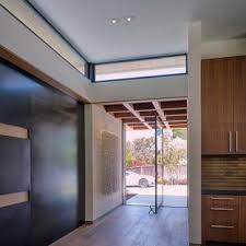 modern glass front door. Example Of A Minimalist Medium Tone Wood Floor Entryway Design In San  Francisco With Beige Walls Modern Glass Front Door