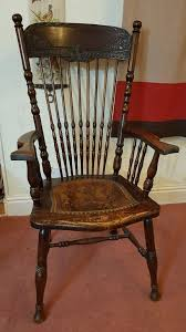vintage wood chair carved with leather seat