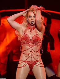 Britney Spears kicks Billboard Music Awards off with pole dancing.