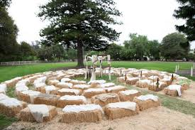 hay bales covered in blankets for ceremony seating
