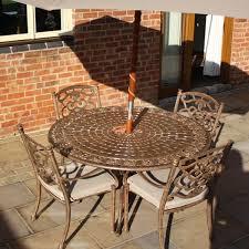 azur 137cm metal round garden dining table azur 4 seater round cast aluminium garden dining