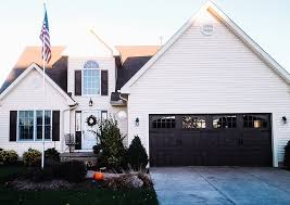 we install and repair steel garage doors and wood carriage house doors for homes in northtowns southtowns