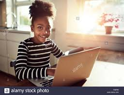 Computerized Hair Style Smiling Black Girl With A Cute Hairstyle Sitting At A Laptop 7913 by wearticles.com
