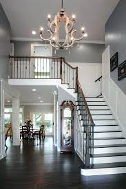 staircase chandelier ideas entryway chandelier ideas staircase traditional with wall art wood handrail gray wall home