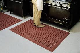 kitchen floor mats. Fine Kitchen Kitchen Accessories Rubber Floor Mats Over Patterned Gray Epoxy  Flooring And Black Cooktop  Throughout