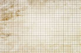 Sheet Of Graph Paper Stained By Coffee Background Stock Photo