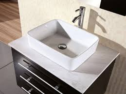 marble top and porcelain vessel sink
