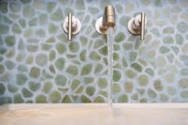bathroom sink running faucet