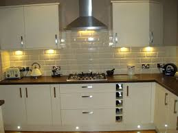 Euro Gloss Kitchen Featuring Under Cabinet Lighting  Cream Kitchen TilesBlack  ...