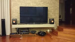 kef ls50 home theater. finally got me a pair of ls50. can anyone help recommend how to best place them on shelf? i attached picture my av setup below. kef ls50 home theater f