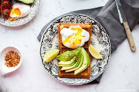 clic waffle with avocado and poached