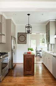 unique small kitchen island ideas wood floor transitional kitchen hanging lamps ceiling lights wall cabinet chair