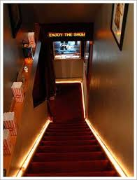 basement stairs looking down. Exellent Down Steps Down To A Home Theater Are Lined With Concessions Carpeted  Thematically And Lit I Like The  Throughout Basement Stairs Looking Down