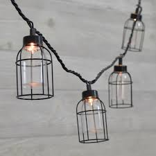 caged lighting. vintage style edison cage string lights caged lighting