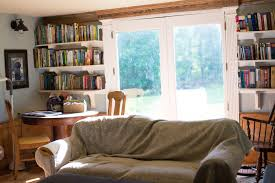 living with add book. this is our main living area. (i feel i should add that the couch typically has a slipcover. it was in wash.) jonny installed shelving on both sides of with book