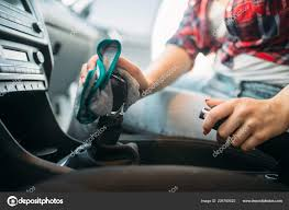 wet cleaning car interior car wash woman self service automobile stock photo
