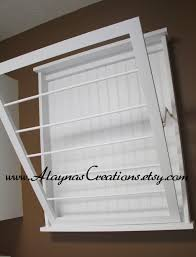 image of wall mounted clothes drying rack laundry room