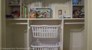 interior white wooden closet shelves with white plastic basket also white rod on white wall