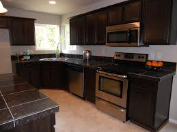 Duracraft Kitchen Cabinets This Lovely Kitchen Has Stone Tile On The Backsplash And Simple