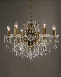 this exuberant six light bronze effect frame crystal chandelier has incredible clear glass crystal beading droplets and cut glass cup holders