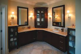 corner bathroom cabinet and storages on double sink bathroom vanity and two framed mirror also wall sconces