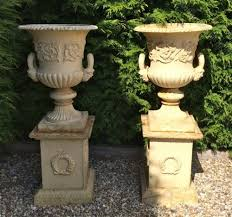 large pair antique cast iron garden urns