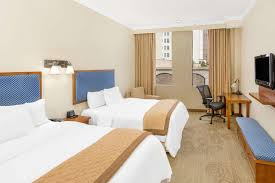 a bed or beds in a room at wyndham garden baronne plaza