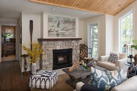 wood fireplace mantels living room beach with art above fireplace blue and white pillows
