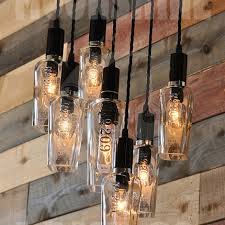 the 209 recycled gin bottle chandelier made of wood and metal with vintage style wrapped cords