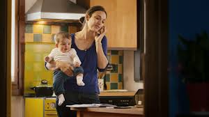 home office multitasking. beautiful office busy woman talking on the phone in kitchen multitasking mom cooking and  working to home office multitasking a