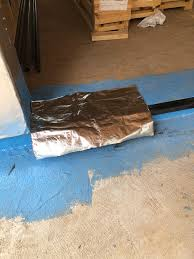 after the blue barrier on the sill was applied they next covered the sill with a layer of polywall s alumaflash plus this 40mil thick l stick give some