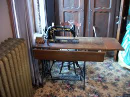 Restored Singer 31-15 industrial treadle sewing machine in my old sewing  room.