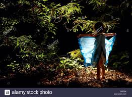 A little girl spreads fairy wings in forest Stock Photo: 309836203 ...