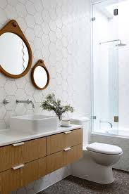 pictures of white tiled bathrooms. white hex tiles on the floors look cool with warm wood touches pictures of tiled bathrooms t