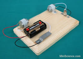 simple electric generator. Push The Button On Left Side And Light Bulb Right Will Up. It Is Almost Like Magic Because There Are No Wires Connecting Simple Electric Generator