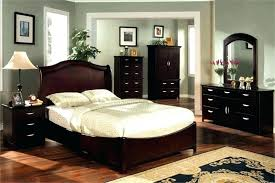 mixed wood furniture in bedroom living room wooden chest blue chair beside mixing white and dark