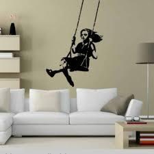 banksy style swinging girl wall sticker