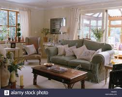 sage green sofa. Delighful Sofa Pale Cushions On Sage Green Sofa Beside Indonesian Wood Table In Country  Sitting Room With Glass Doors To Conservatory For Sage Green Sofa O