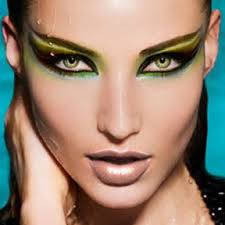 in this picture we see a lot of egyptian influence in the make up used in the models the ancient egyptians are knonwn for there thick eye make up giving