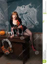 Awesome Beautiful Young Girl With A Vampire Costume Posing In Studio. Portrait